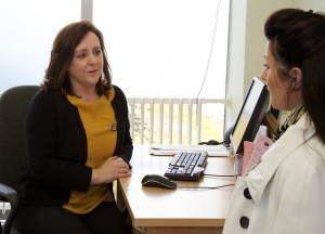 photo of two women sitting at a desk for a Brave consultation