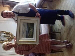 photo of Clodagh and Neven holding the painting