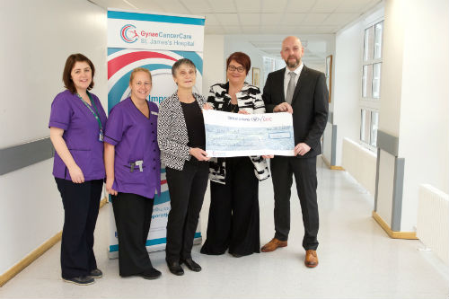 Photo of Susan Carry cheque presentation with group